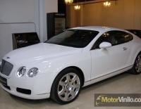 Bentley forrado integral con Vinilo blanco brillante