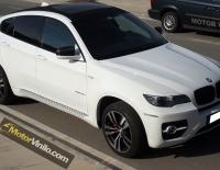 BMW X6 con Vinilo carbono en el techo