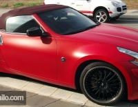Nissan forrado integral con Vinilo rojo mate
